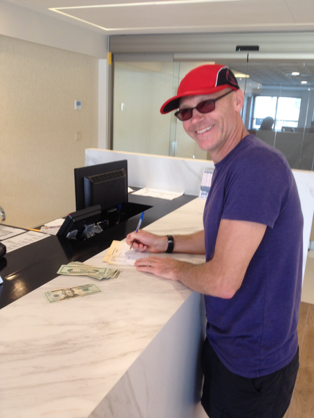 Collecting my $150 at the Garza Blanca Resort