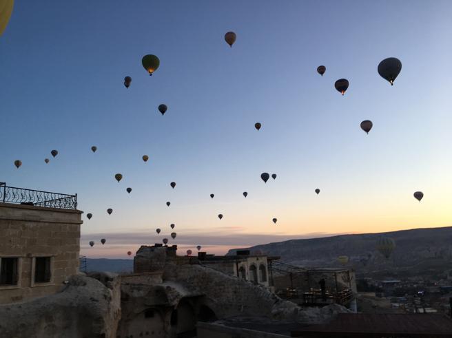 Tourists in Goreme, taking hot air balloon rides: