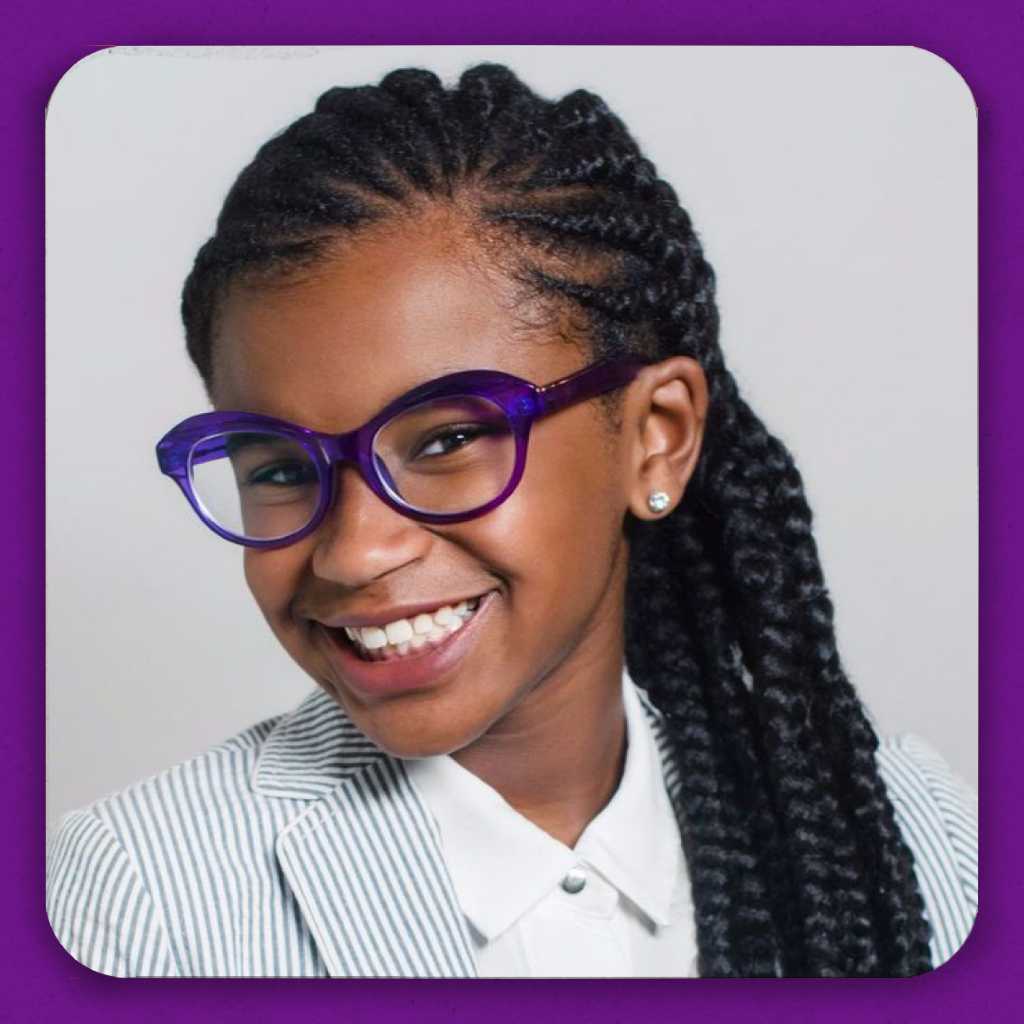A smiling black girl in some stylish purple glasses