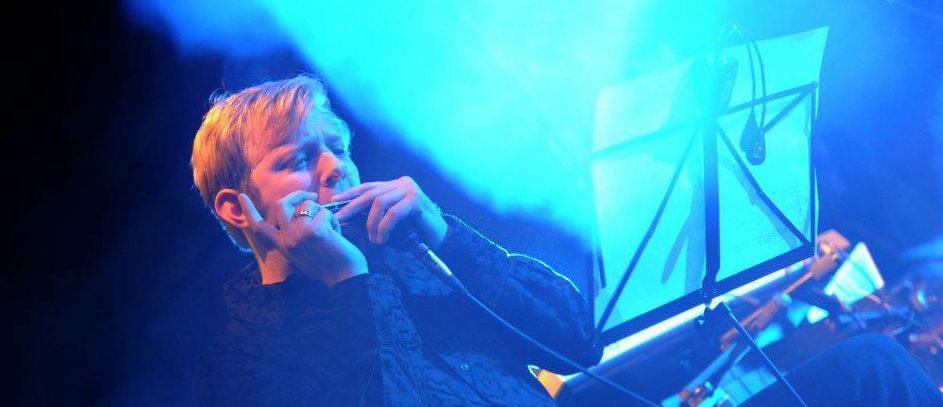 Joe Powers playing Harmonica