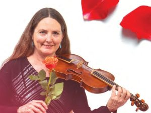 woman holding a rose and violin