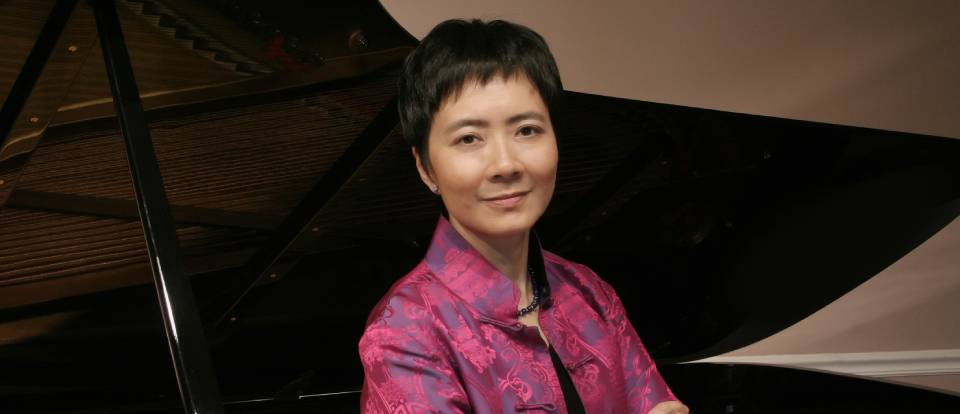 Pianist Susan Chan by piano
