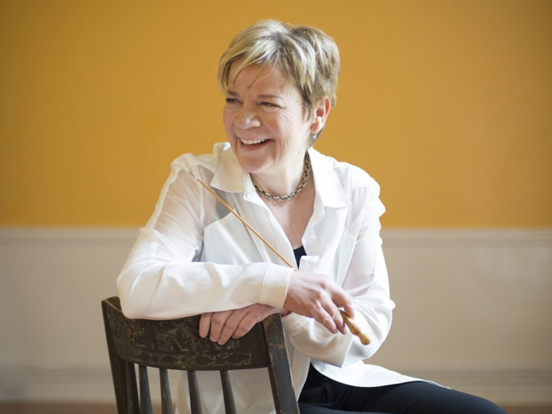 photo of marin alsop smiling with baton