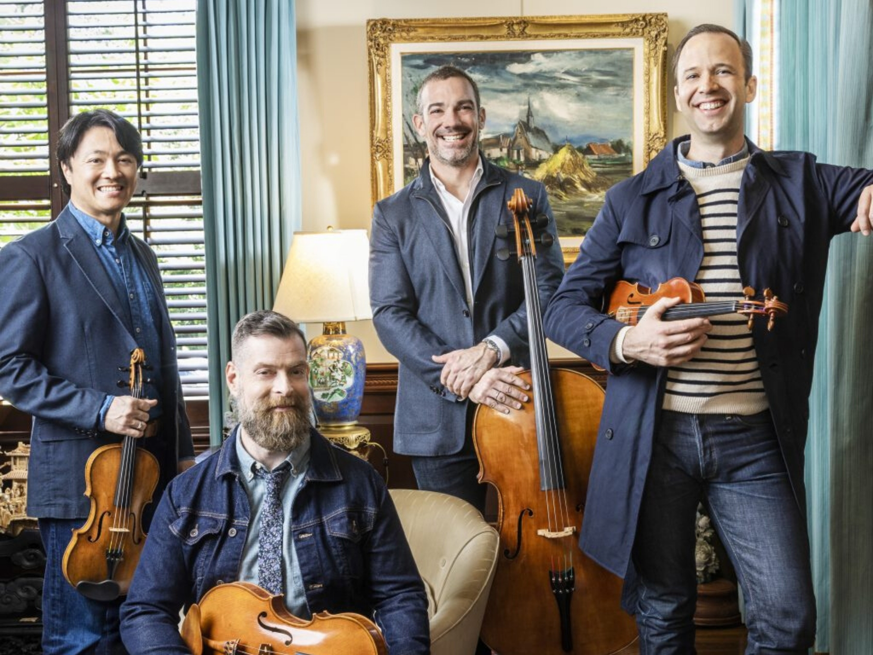 chamber musicians in denim outfits