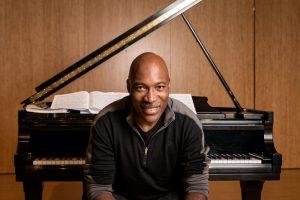Darrell Grant at a piano