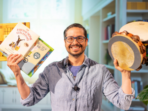Man holding books and instruments