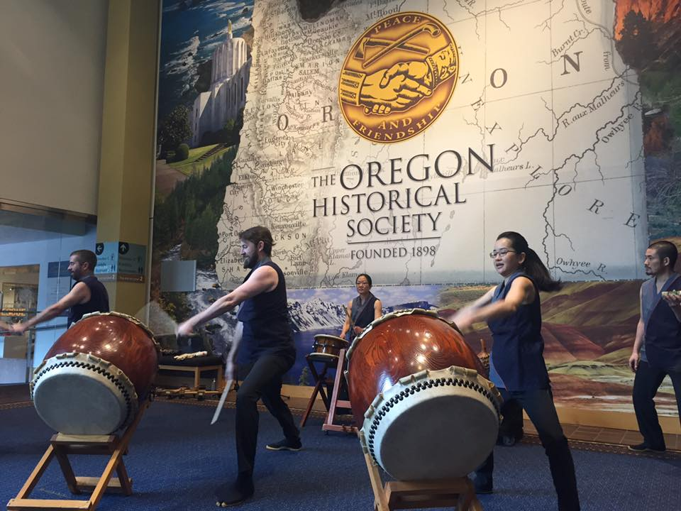 Taiko in front of an OHS sign
