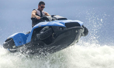 Quadski rider speeding thru water