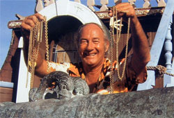 Treasure hunter Mel Fisher with gold chains found on the wreck of the Atocha