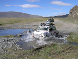 A car crossing the stream in the middle of nowhere on the MOngol Rally