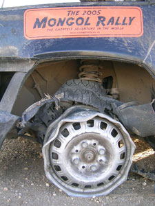 blown tire on a car running the Mongol Rally