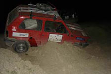 car stuck in the sand during the Mongol Rally