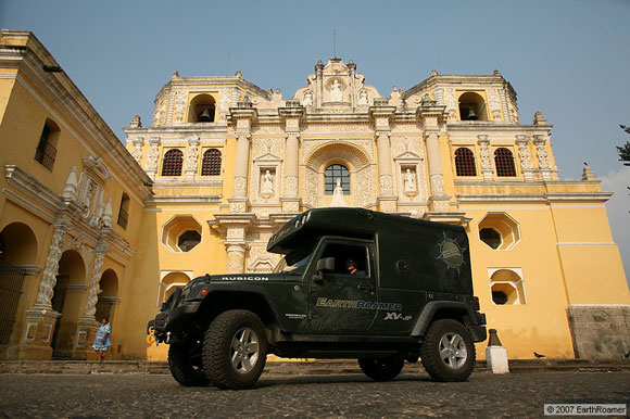 earthroamer all terrain vehicle in front of an old church
