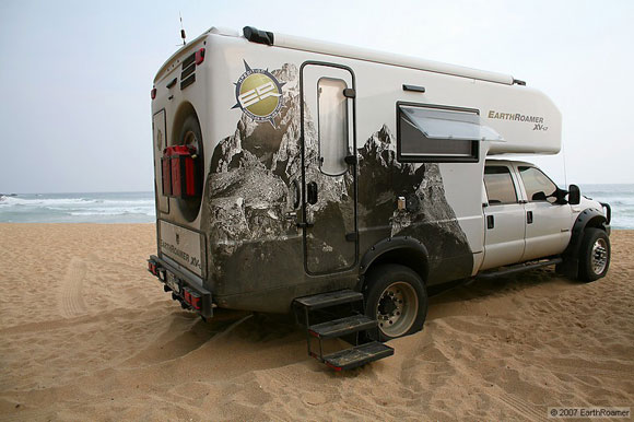 earthroamer-xl all terrain vehicle in camping mode on the beach in Central America