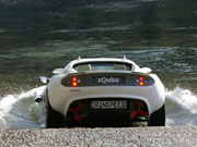 sQuba submersible sports car seen from behind entering the water