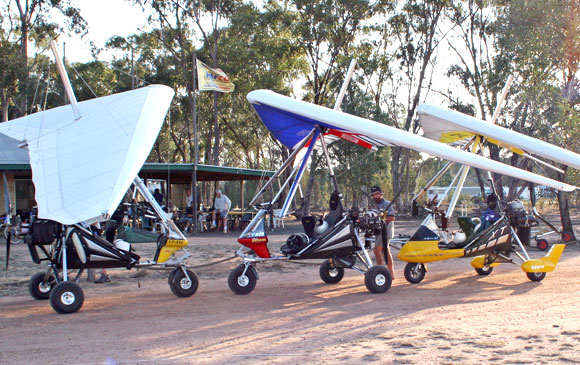 Three Ultralight Trikes parked in a remote camping location