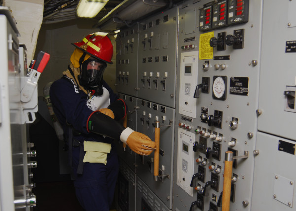 closed-inspection-of-panel-while-wearing-ppe