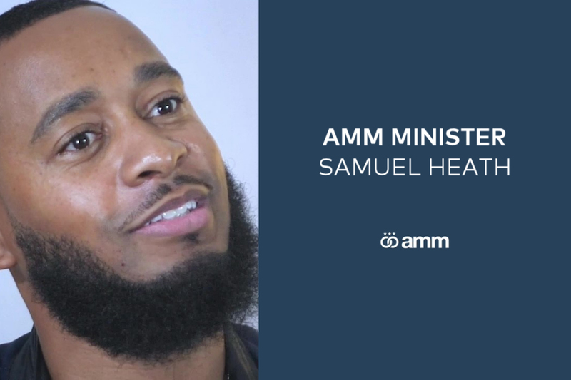 Image is a screenshot of AMM Minister and professional wedding officiant Samuel Heath, taken from the interview in which he talks about love, Samuel is smiling with his head tilted slightly to the side