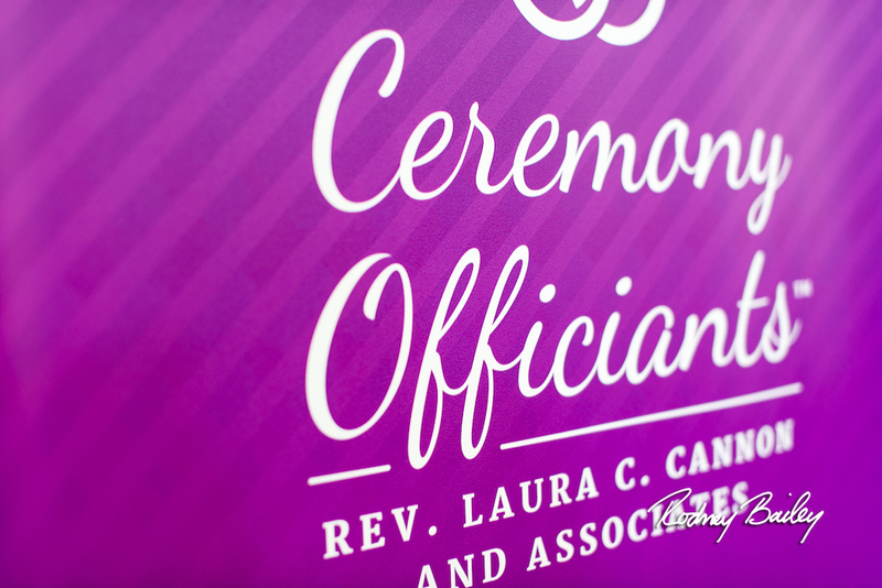 """image is of a fushia background with white script lettering on it, reading """"Ceremony Officiants"""" and below, Rev. Laura C. Cannon and Associates, this is the image of Laura's wedding officiant business logo"""