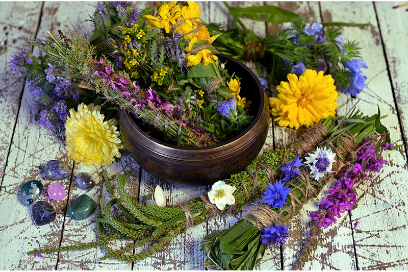 Photograph shows many flowers and herbs arranged in bundles, ready to be used for ritual bathing