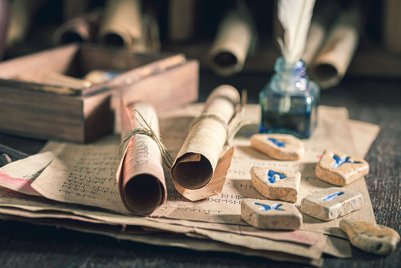 Wedding invitations, a scroll of paper with runes
