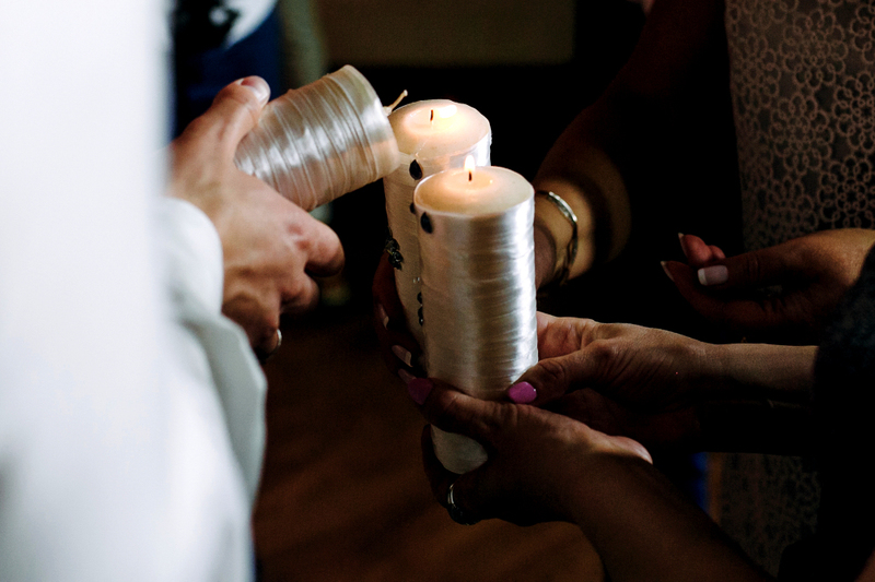 image of couple lighting candles in a unity ceremony to learn how to perform a commitment ceremony
