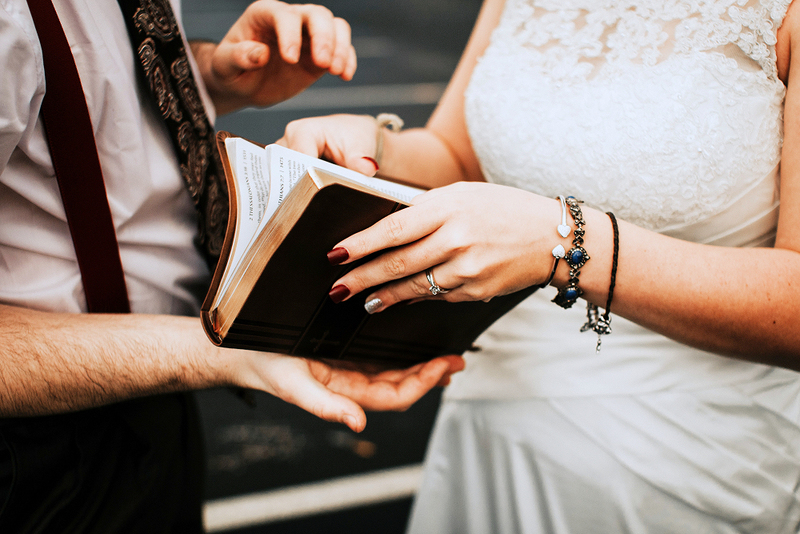 bride and groom reading selection at wedding ceremony, tradition and culture, how to officiate a wedding