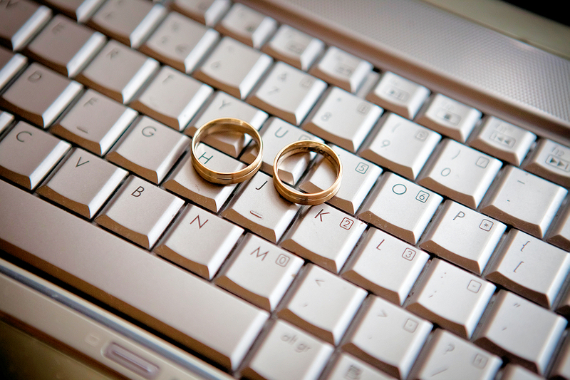image of a computer keyboard with wedding rings to represent online marriage, virtual wedding ceremony, or zoom wedding
