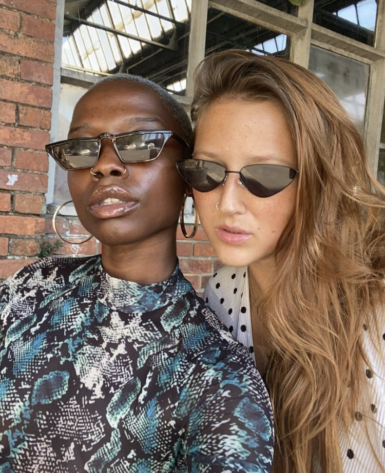 photo is of Chiderah Sunny and Deidre Olsen, the two are wearing sunglasses and posing for the camera, via Deidre Olsen's instagram account