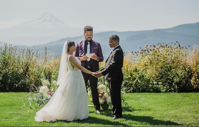 Officiant jimmie marries a couple in beautiful outdoor wedding