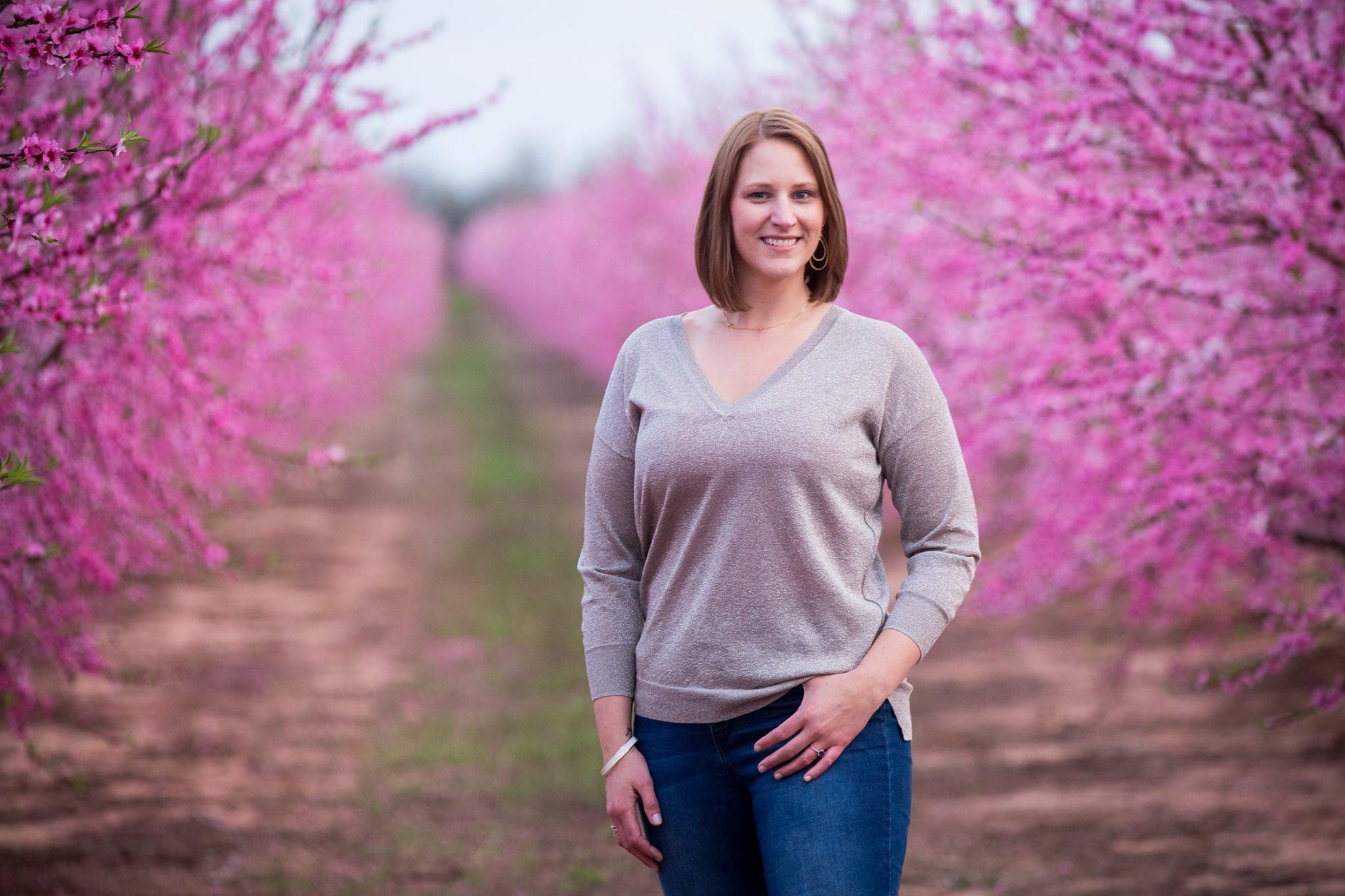 Margo huggins in peach orchard