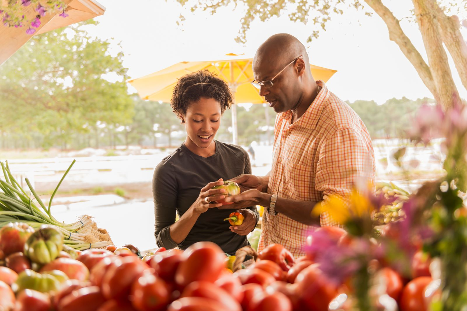 Couple Picking Out Produce in Farmers Market