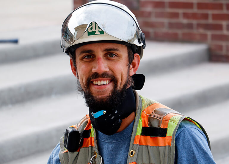 Man with a hard hat and construction vest
