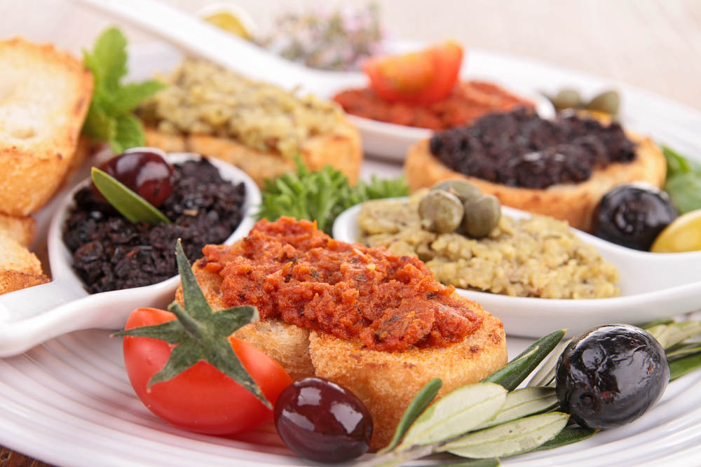 Assortment of tapenade and toast. Photo: Shutterstock