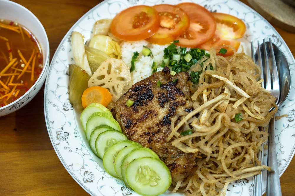 Vietnamese broken rice with grilled pork chop. Photo: Shutterstock