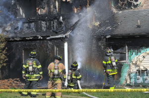 Fort Lee firefigters extinguish a fire April 20 in the jackson Circle neighborhood.