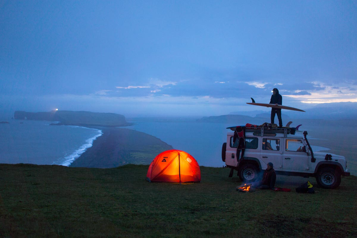 Chris Burkard photo of illuminated tent at nightfall next to jeep