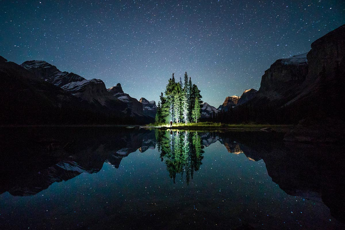 Chris Burkard photo of starry skies reflected in alpine lake