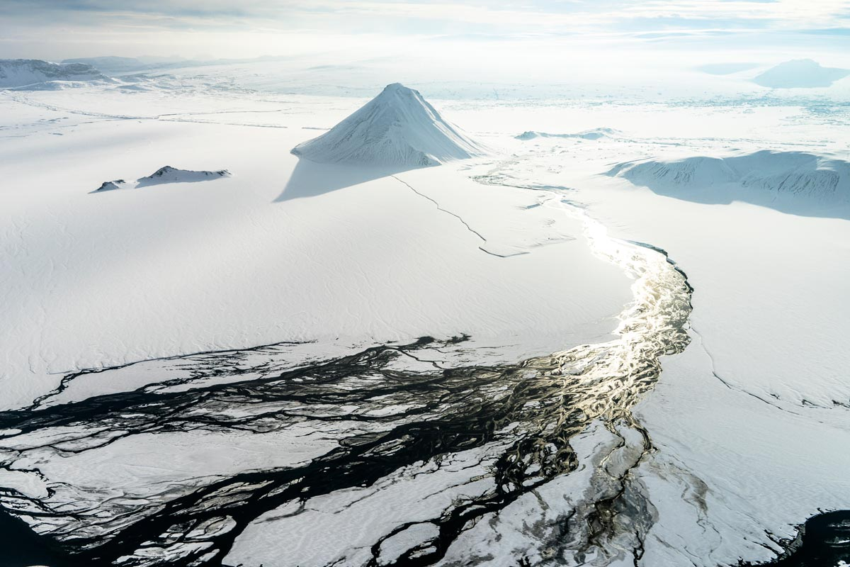 Chris Burkard overhead photo of cracking ice in arctic setting