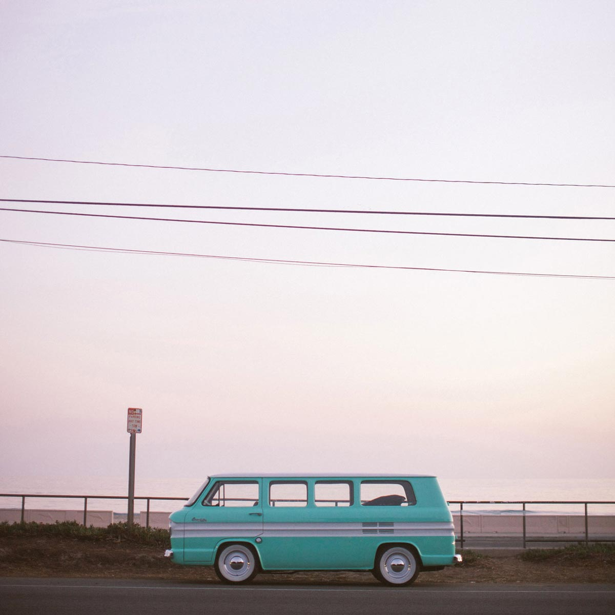Photo by Max Wanger of Volkswagen camper on coastal highway at sunset