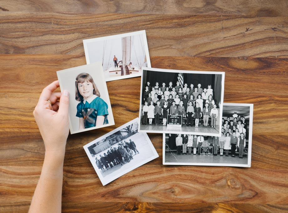 Old photos on wooden table