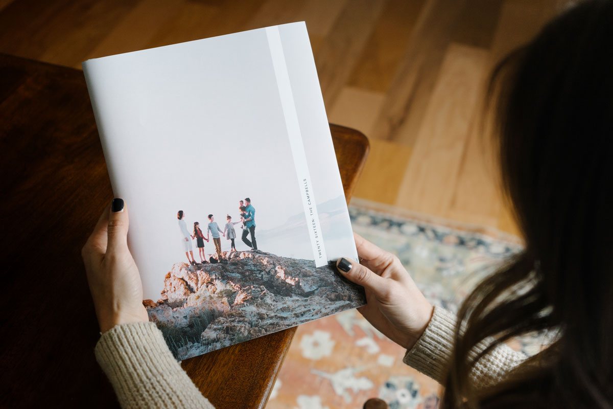 family hiking photo on book cover of year-in-review photo book