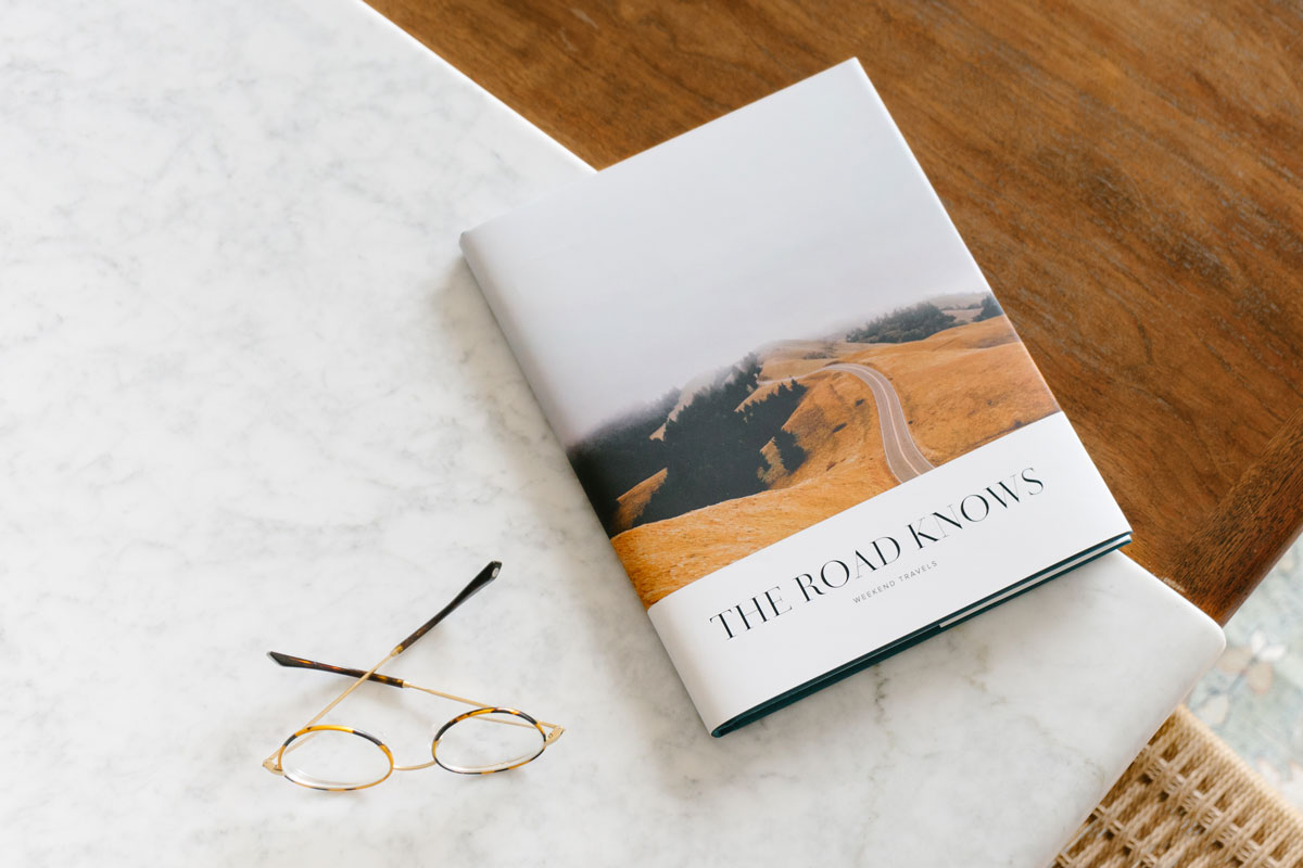 travel photo book with winding road on book cover