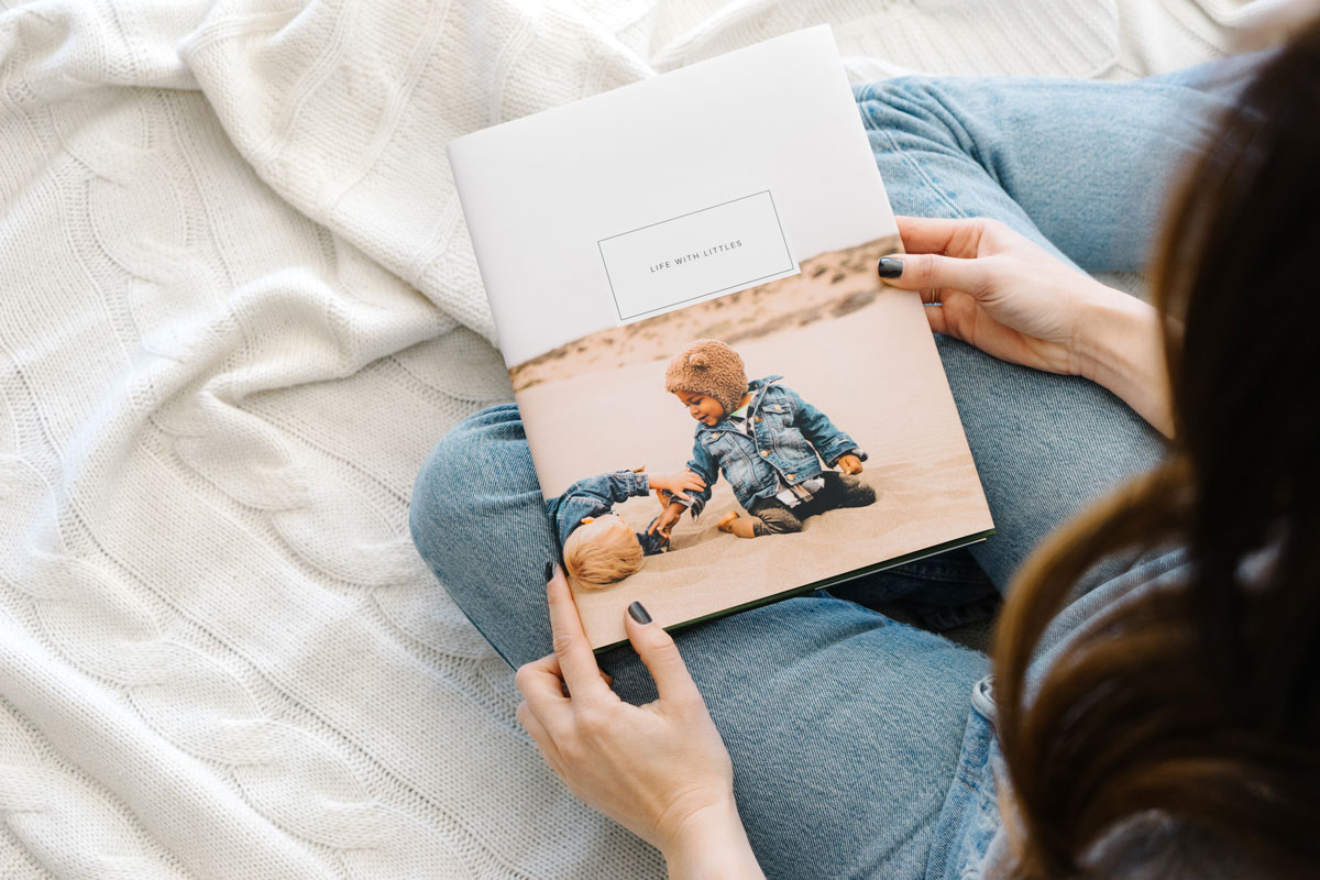 Small children playing in sand on cover of photo book titled Life With Littles