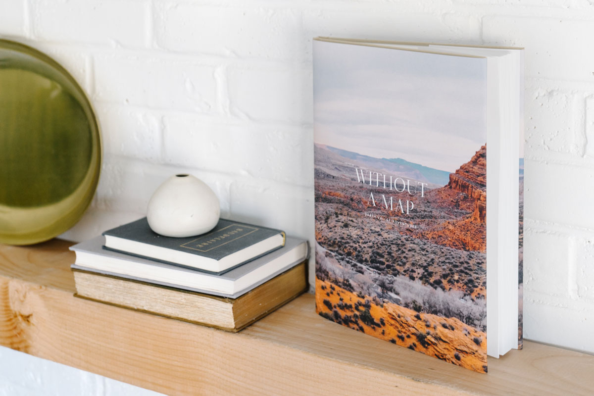 Colorful photo of red rock formations on cover of photo book