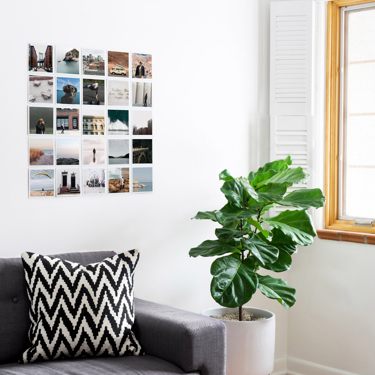 Grid of photo prints on wall above couch