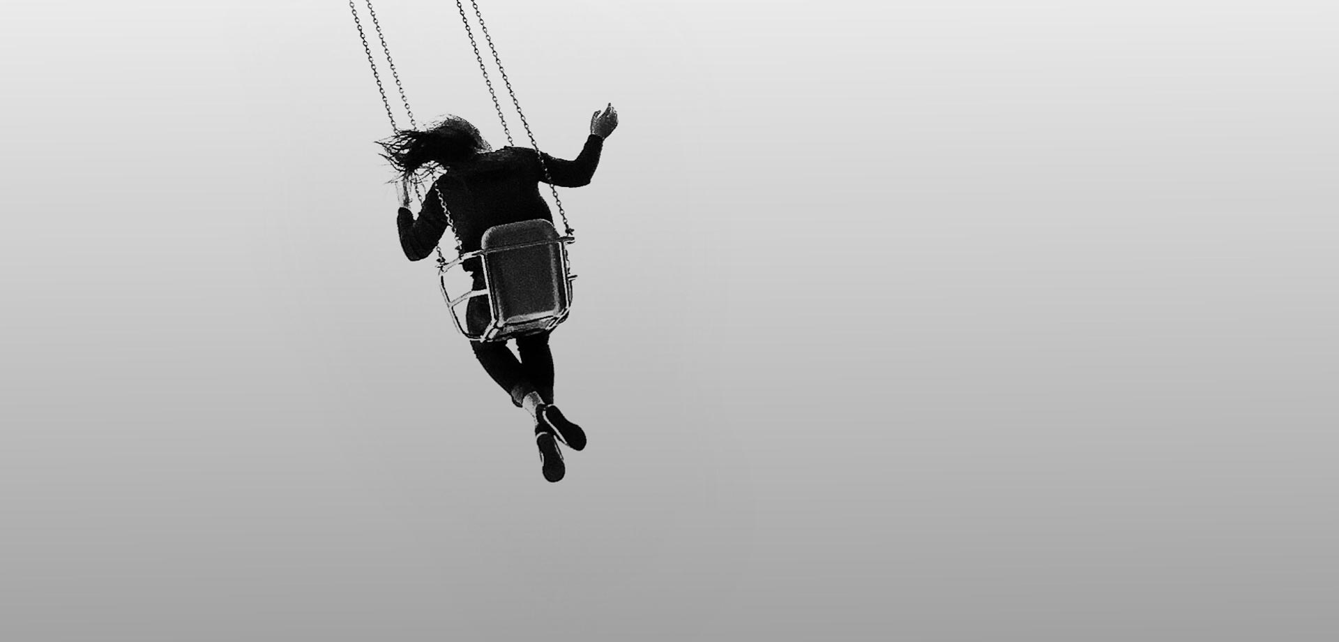 Photo by Jason Peterson of girl in swing represents tips for black and white photography