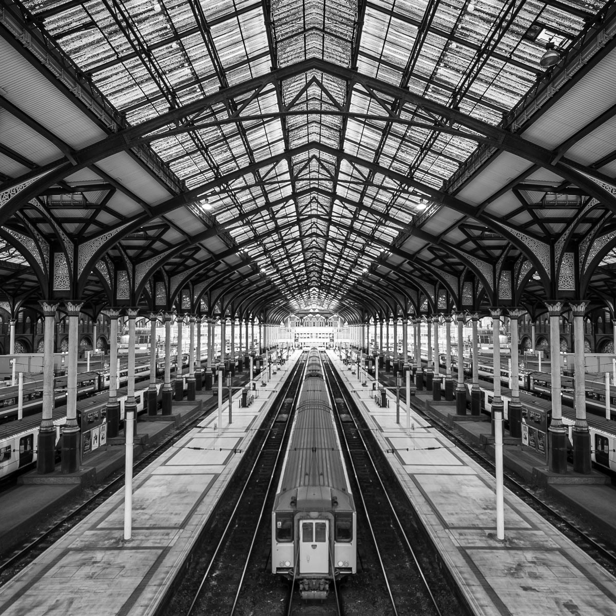 Black and white photo by Jason Peterson of train leaving train station