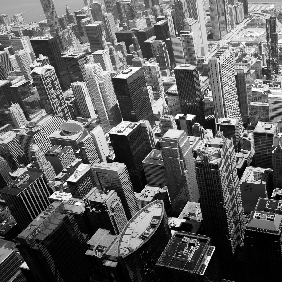 Overhead shot of the city in black and white by Jason Peterson