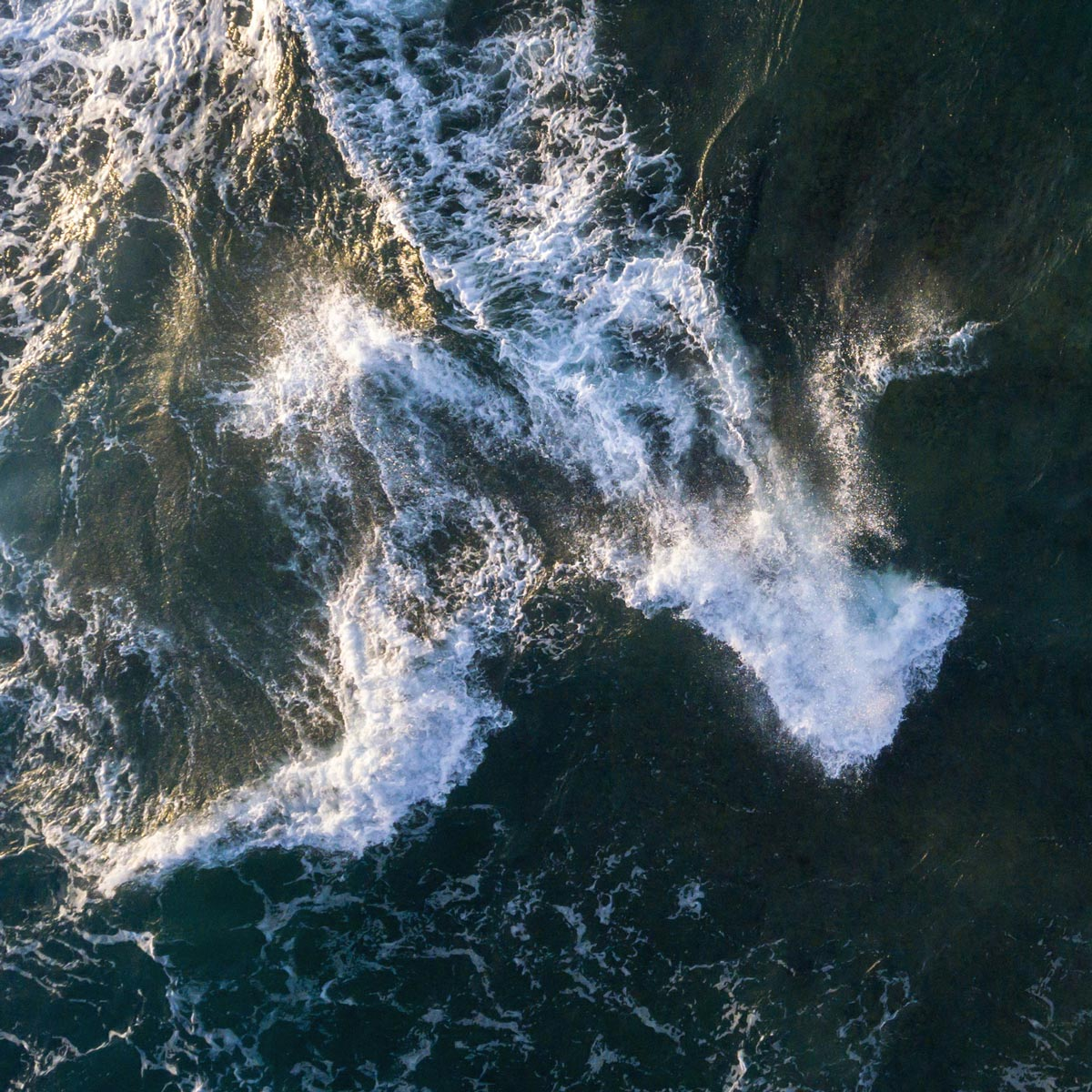 Photo by Christian Schaffer of waves shot from over the ocean